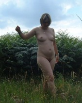 Free porn pics of Naturist wife outside in the field 1 of 8 pics